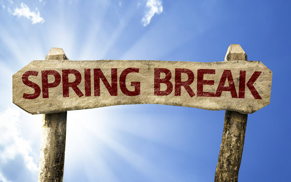 Spring Break wooden sign on a summer day