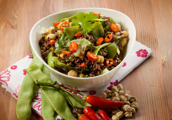 red rice with flat green beans chickpeas leek hot chili pepper
