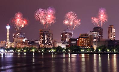 Fireworks celebrating over Yokohama cityscape at night