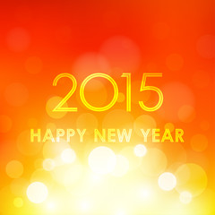 happy new year 2015 in bokeh and lens flare orange background