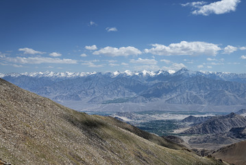 View of green leh valley and majestic range of Himalayas
