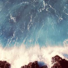 Vintage photo sea landscape, wave and rocks, soft pastel colors