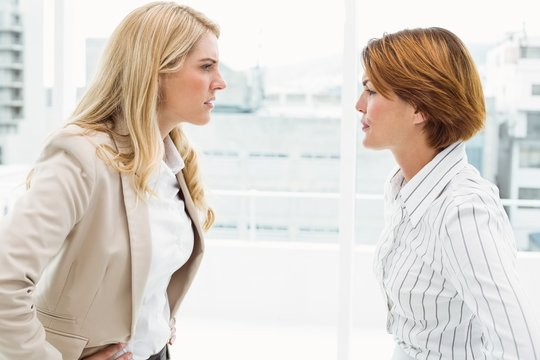 Colleagues in an argument at office