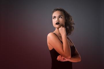 Woman in black dress.