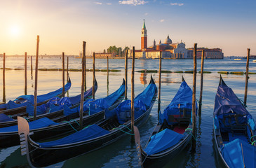 Beautiful view of Venice with gondolas at sunrise