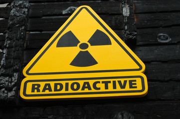 Radioactive Sign on Burned Wooden Background
