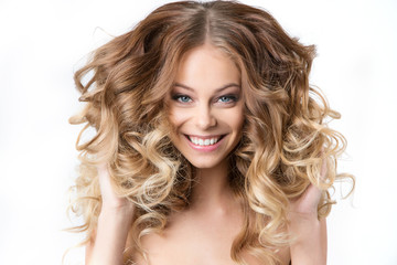 Portrait smiling girl with luxuriant hair curling.