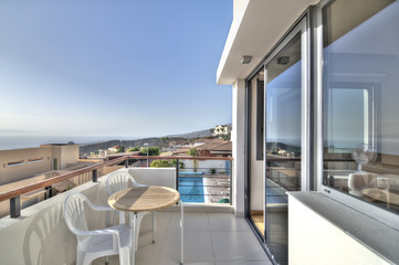 Balcony with ocean and pool view in the modern villa