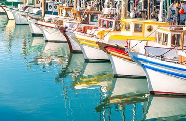 Photo sur Plexiglas San Francisco Colorful sailing boats at Fishermans Wharf of San Francisco