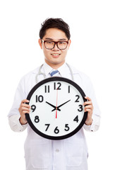 Asian male doctor show a clock