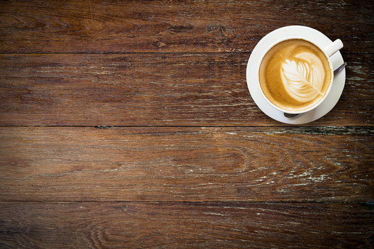 latte coffee on wood with space.