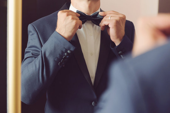 Groom with Bowtie before Mirror
