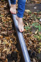 bare female feet on rails
