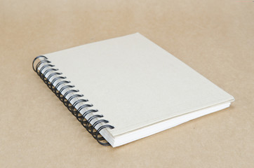 notebook on brown background