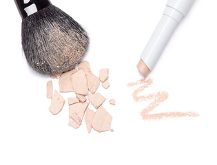 Concealer pencil and crushed compact cosmetic powder with makeup