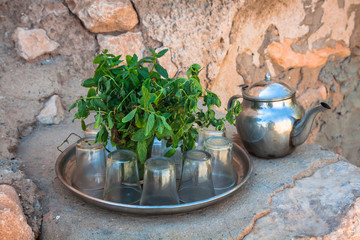 Mint tea: a kettle and a glass