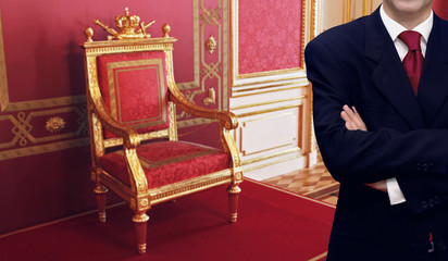 Man standing inside luxury royal palace interior