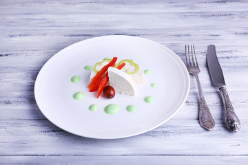 Cottage cheese with vegetables, knife and fork