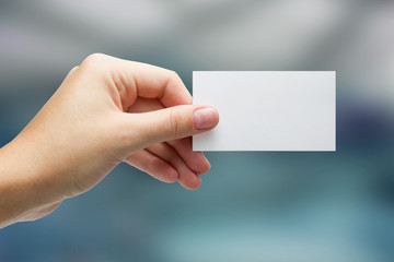 Hand holding white business card on blurred background buy this category business meetings and partnerships colourmoves