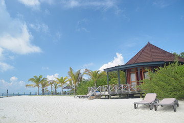 Resort chalets next to white sandy beach