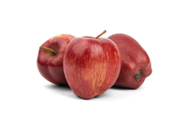 three red ripe apples on a white background