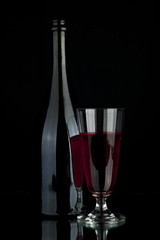 glass and bottle with wine