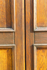 in mozzate  a  door curch  closed metal wood italy  lombardy