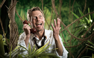 Furious businessman on the phone lost in the jungle