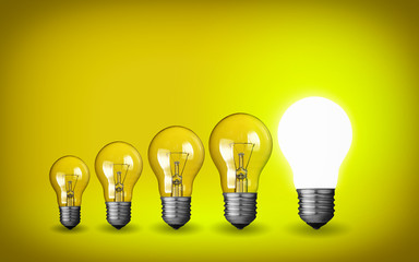 Row of light bulbs.Idea concept on yellow background.