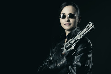 Attractive female agent with raised gun