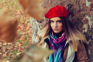 Beautiful young women with a red beret
