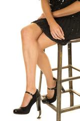 woman legs black skirt and heels sit