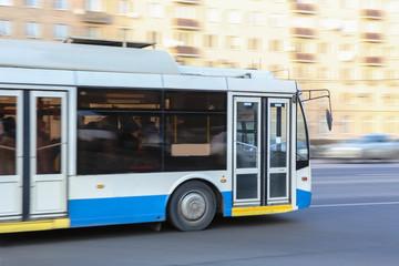 bus goes along street