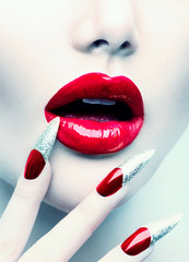Spoed Fotobehang Fashion Lips Makeup and Manicure. Red Long Nails and Red Glossy Lips