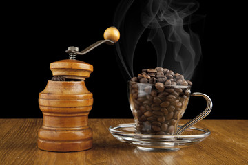 grinder and a Cup of coffee