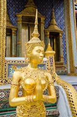 Golden Kinnari statue at the temple of the Emerald Buddha
