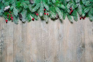 Wall Mural - Christmas fir tree on a wooden board