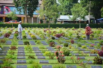 Traveler foreigner visit Kanchanaburi War Cemetery (Don Rak)