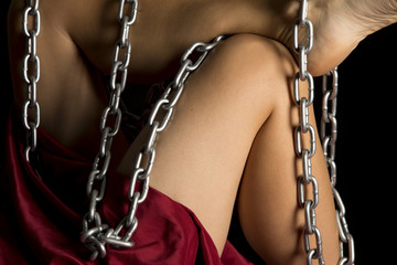 woman legs and red sheet on black chain wrapped around