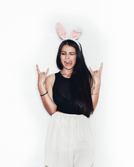 Sweet girl in pink bunny ears having fun on white background