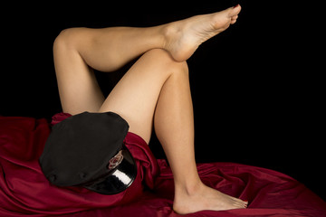woman legs with red sheet black back police hat