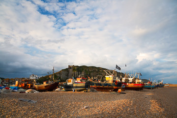 Boats in Hastings harbour and the East Hill, UK.