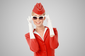 Charming Stewardess Dressed In Red Uniform And Vintage Sunglasse