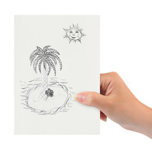 Hand with drawing tropical island