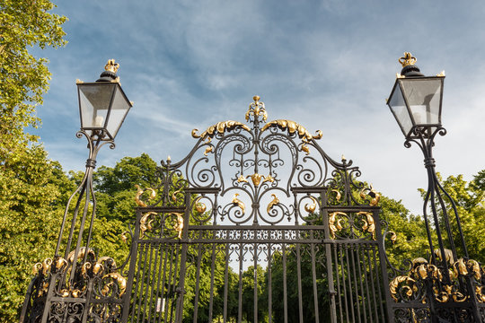 Metal  Gates, fence and street lamp.  London, England