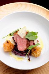 Roast duck, red cabbage and dry fruits in fine dining restaurant