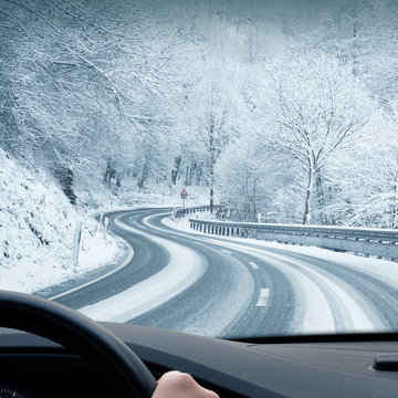 Winter Driving - Curvy Road Leading Through a Mountain Landscape