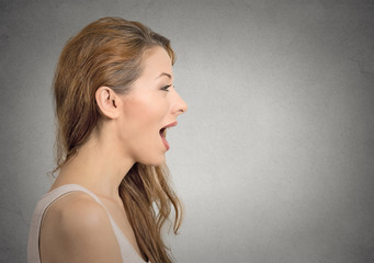 woman talking with sound coming out of her open mouth