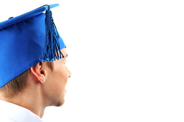 Man graduate student wearing graduation hat and gown, isolated