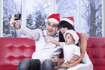 Joyful family taking picture together